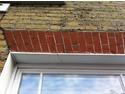 Repointing, brick repair and window sill repair