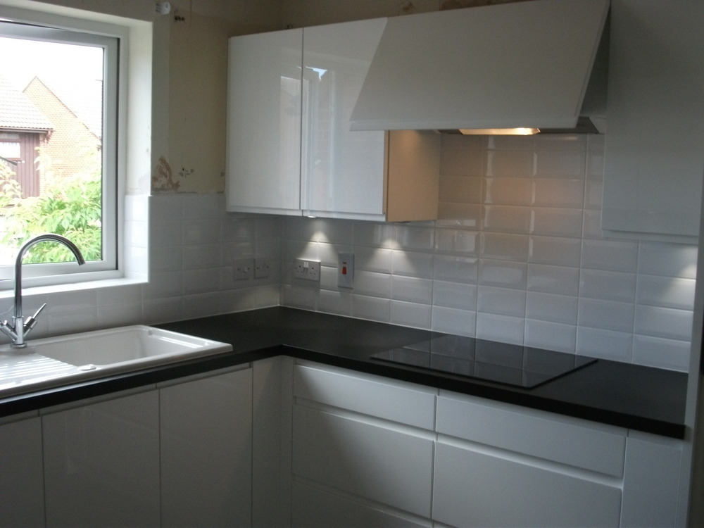 Kitchen supplied by wren modern handle less white gloss for White high gloss kitchen wall units