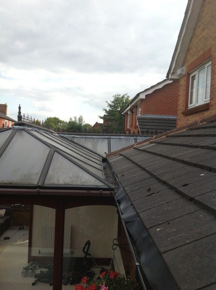 Box guttering leaking into conservatory - Roofing job in ...