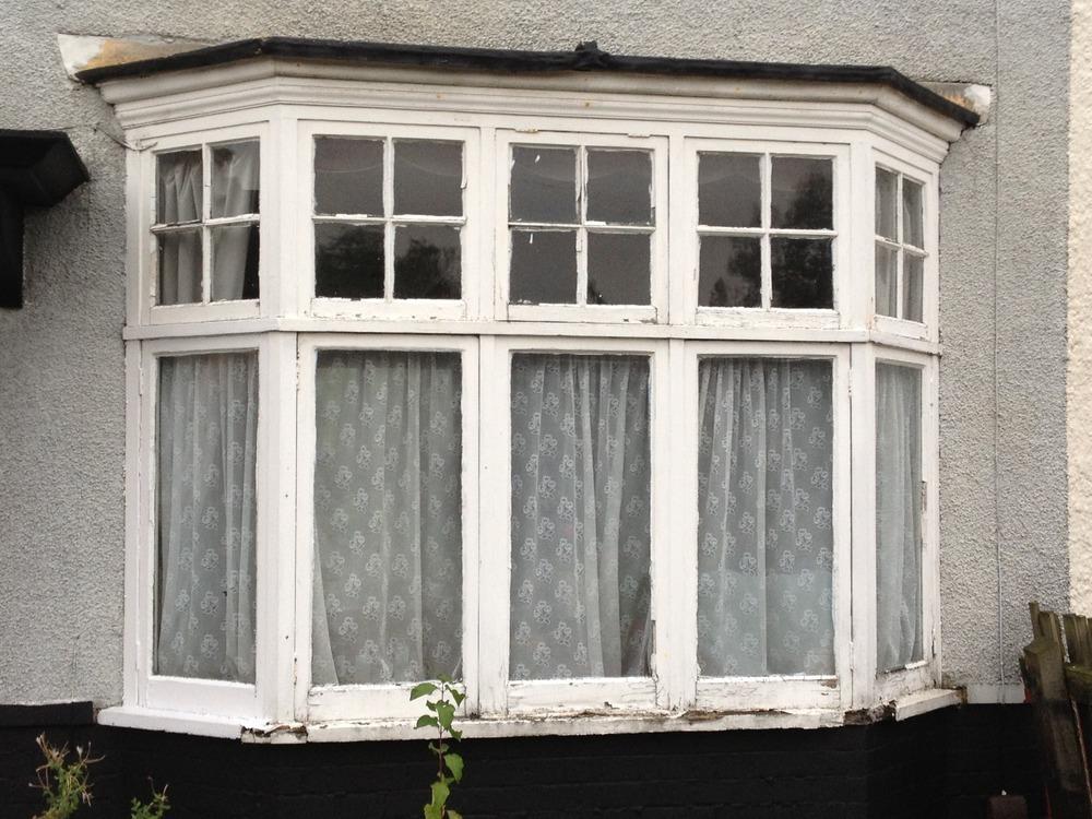 1930s bay window and door replacing windows job in