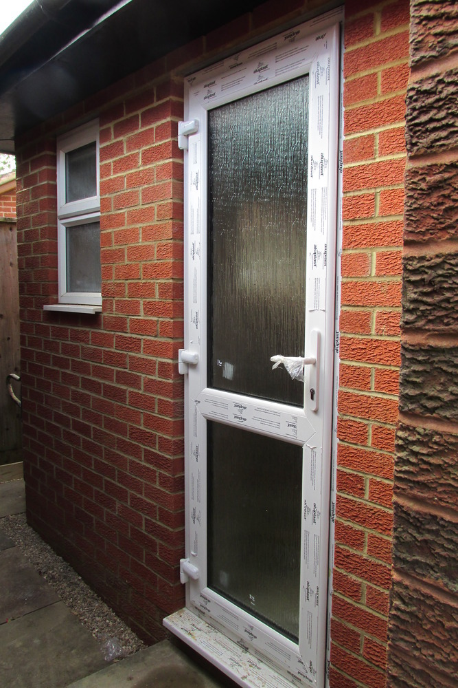 A j property services 100 feedback kitchen fitter for Kitchen back door with window