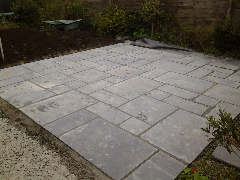 patio dug out base laid and cut slate patio slabs laid in a random