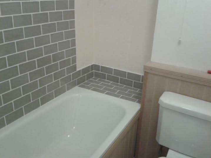 Tiling a bathroom floor around a toilet