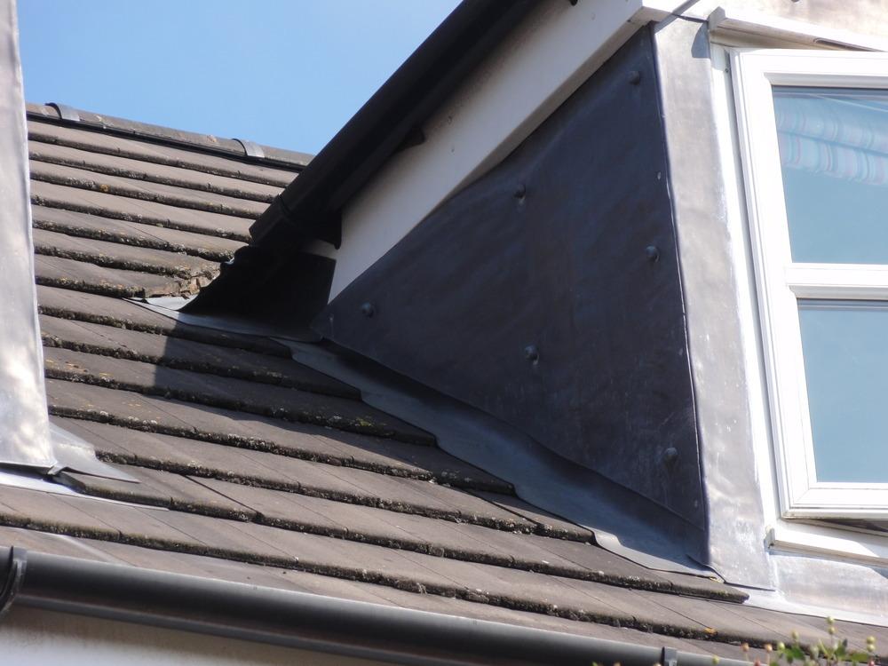 Repair lead flashing on dormer window roofing job in kenilworth