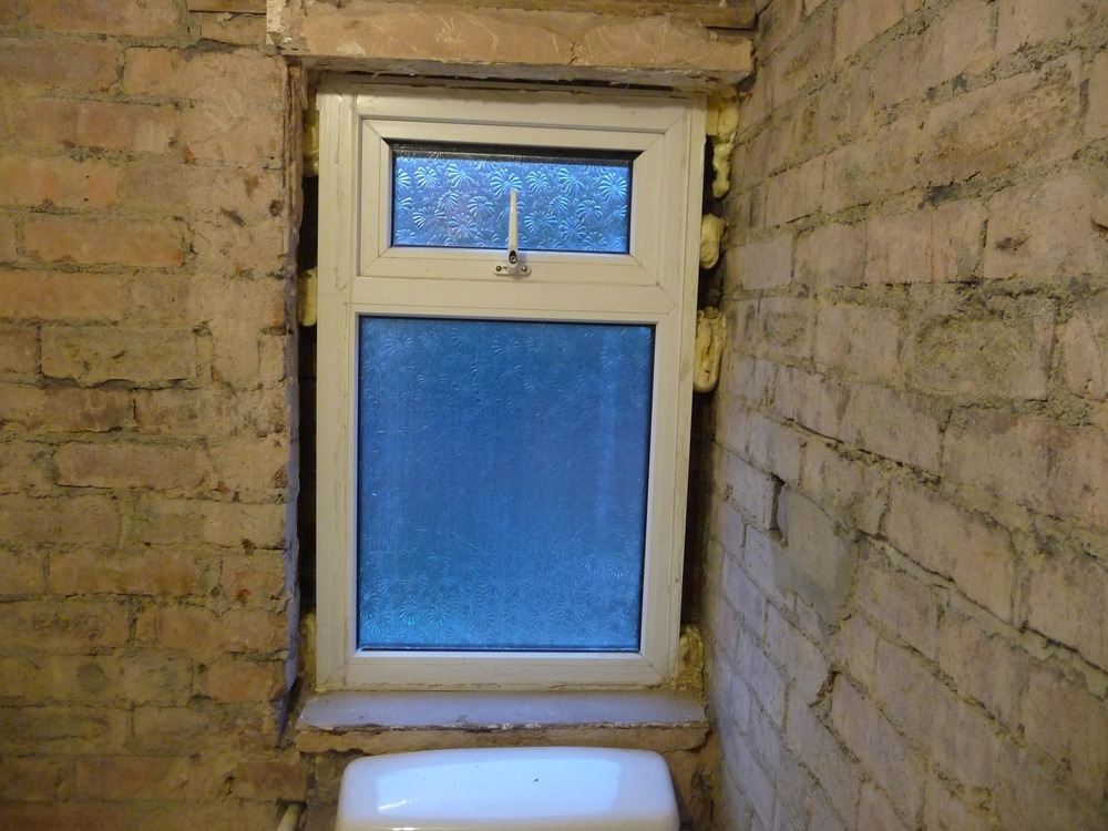 new upvc window supplied and fitted in bathroom 25x40