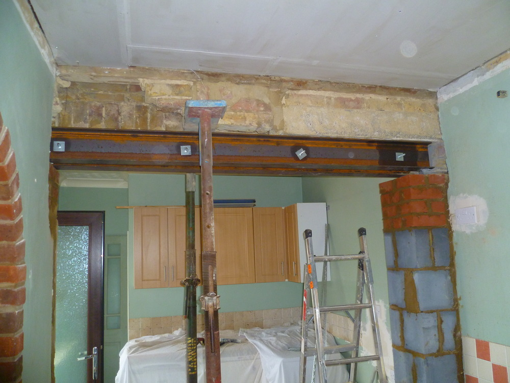 Removed wall to extend kitchen using 2 steel beams for load bearing