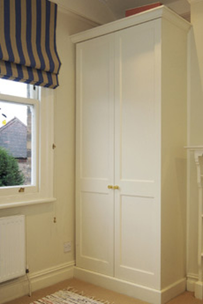 Built in wardrobe in sloped alcove in loft room Pictures of built in wardrobes