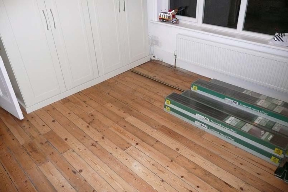 lay laminate flooring in one first floor bedroom