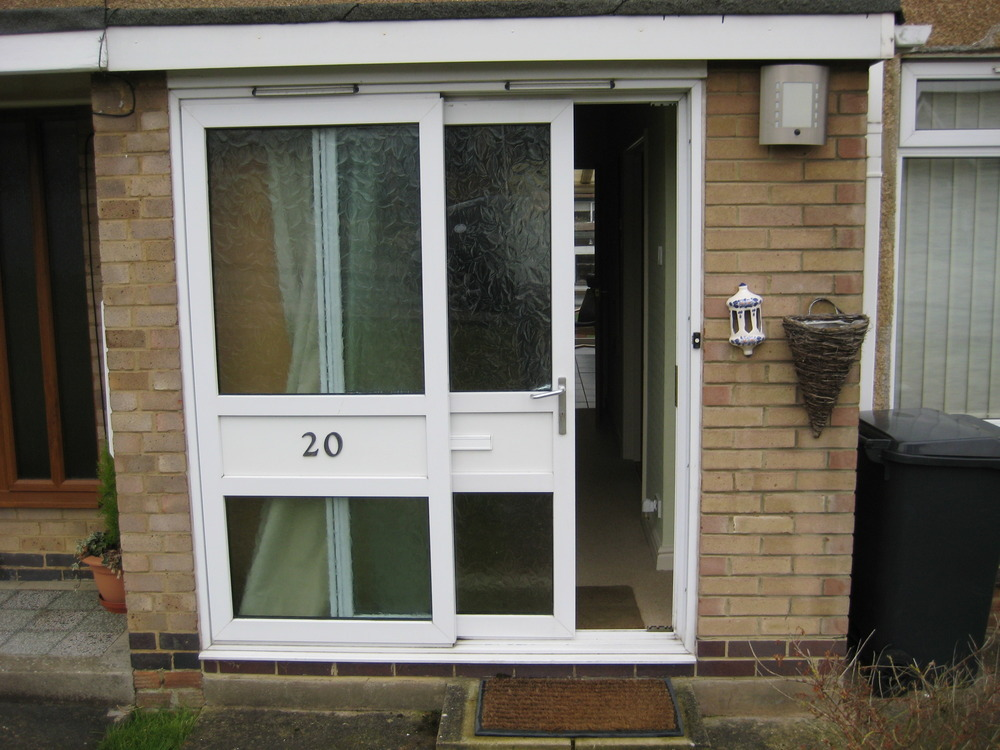 Supply and fit upvc front door and side panel windows for Exterior doors fitted