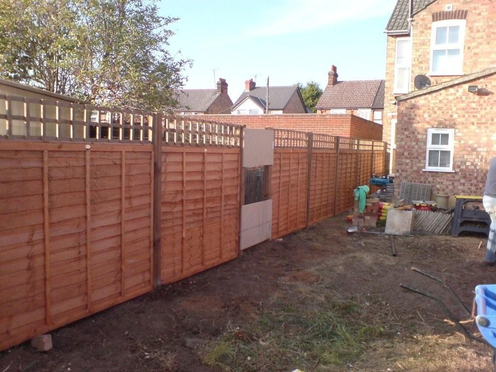 Fencing a small terrace house garden fencing job in for Terrace fence