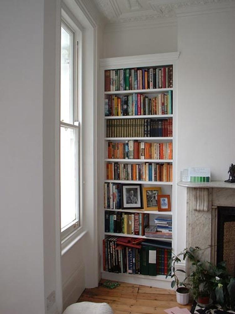With built in shelves on side custom built floating shelves