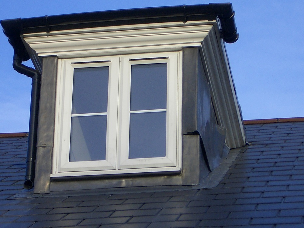 Lead cladding on two dormer windows has slipped roofing job in