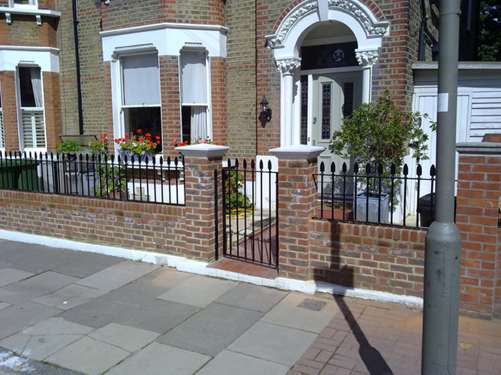 Garden wall with railings for small victorian house Victorian house front