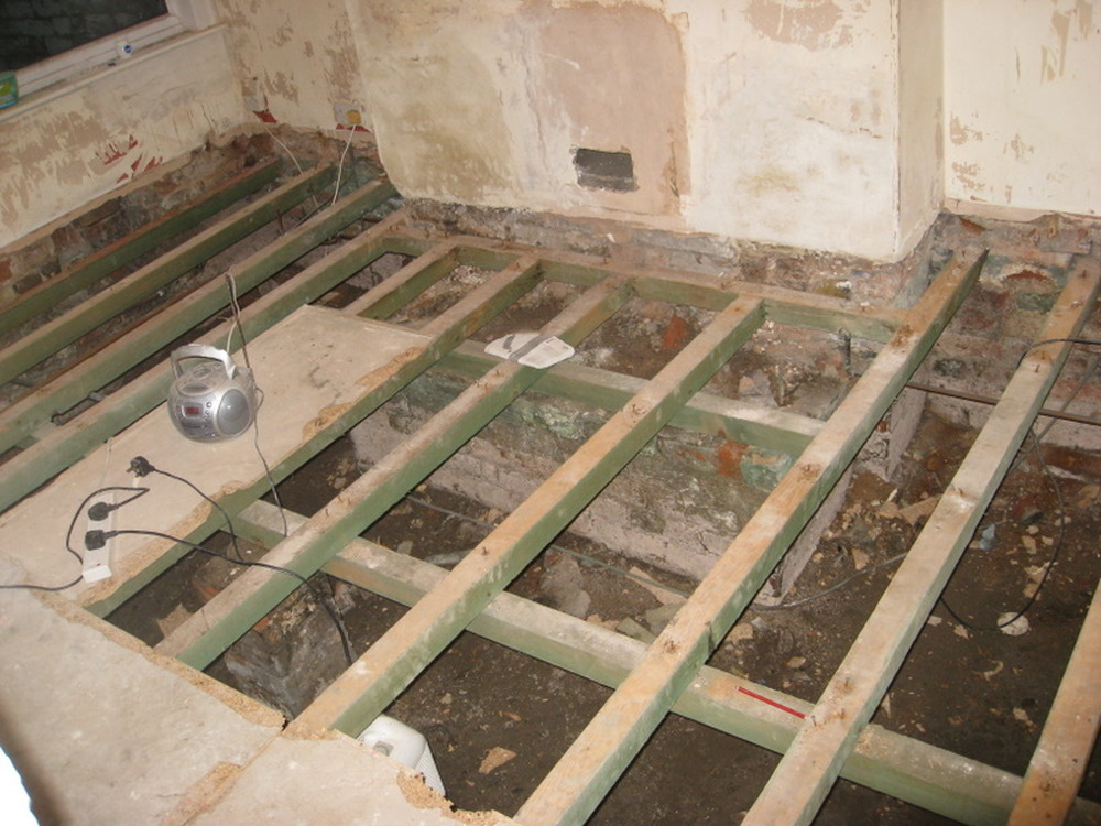 Strengthen joists and lay chipboard T&G flooring ...