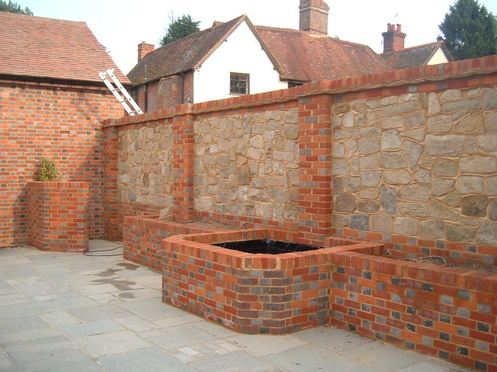 Dougcusdenlandscapes 100 feedback landscape gardener for Brick wall garden designs