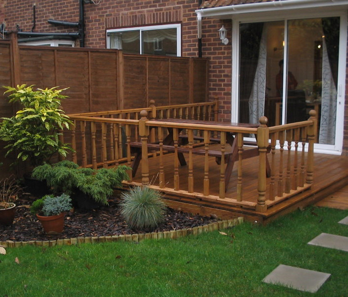 Barton fencing decking 100 feedback fencer in manchester for Decking for back garden