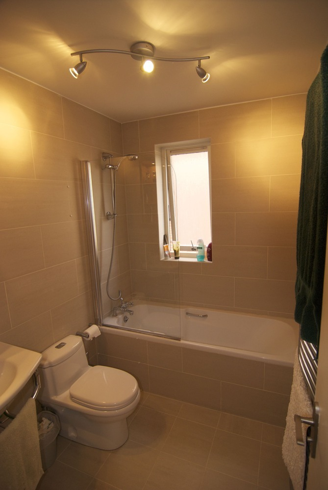 Remove Old Bath Tub And Fit New One Retile Around It Bathroom Fitting Job In Canary Wharf