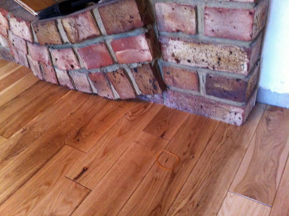 Laminate flooring how to trim laminate flooring around for Wood floor up to fireplace