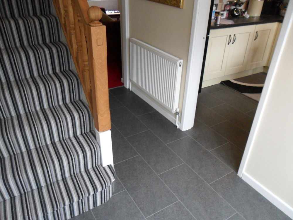 Striped Carpet To Stairs With A Brick Laid Vinyl Tile To