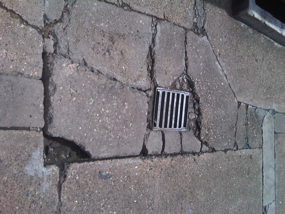 Repair Concrete Yard Area And Reset Drainage Grills